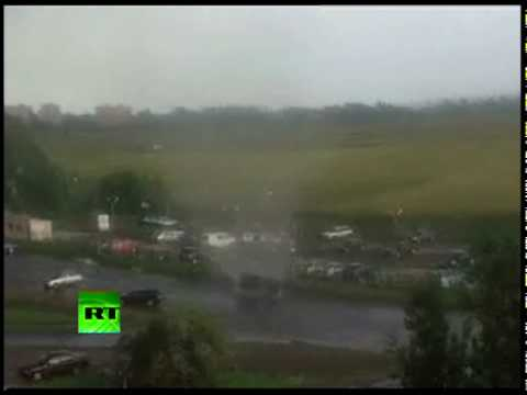 Video of flying cars as wild tornado hits